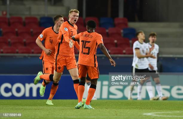 Perr Schuurs of Netherlands celebrates with Tyrell Malacia after scoring their side's first goal during the 2021 UEFA European Under-21 Championship...