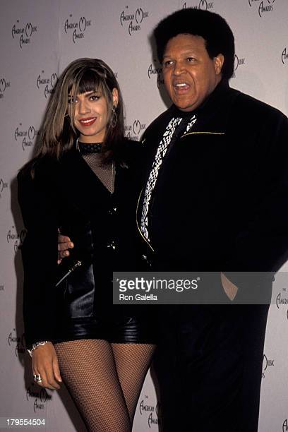 Perri Pebbles Reid and Chubby Checker attend 18th Annual American Music Awards on January 28 1991 at the Shrine Auditorium in Los Angeles California