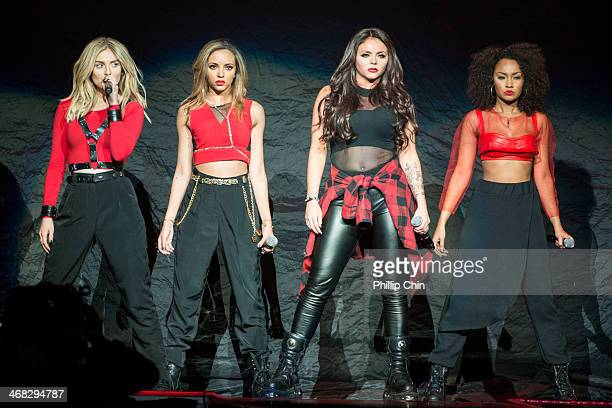 """Perrie Edwards, Jade Thirlwall, Jessica Nelson and Leigh Anne Pinnock of Little Mix perform the opening act for Demi Lovato's first concert of """"The..."""