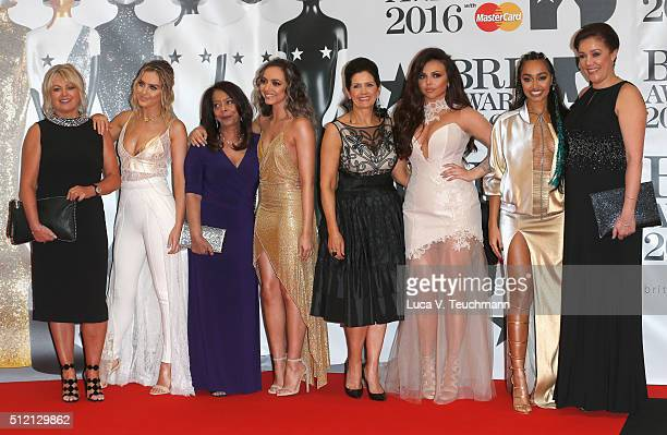 Perrie Edwards Jade Thirlwall Jesy Nelson and LeighAnne Pinnock from Little Mix with their mothers attend the BRIT Awards 2016 at The O2 Arena on...
