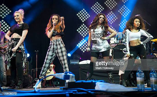 Perrie Edwards, Jade Thirlwall, Jesy Nelson and Leigh-Anne Pinnock of Little Mix performing on stage on Day 3 of Isle Of Wight Festival 2013 at...