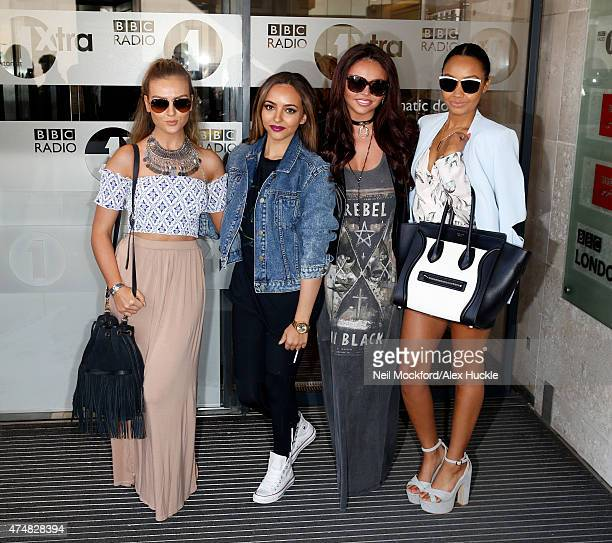 Perrie Edwards Jade Thirlwall Jesy Nelson and LeighAnne Pinnock of Little Mix pose for pictures as they leave the BBC Radio 1 Studios on May 27 2015...