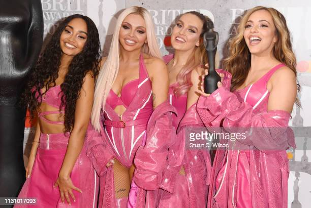 Perrie Edwards Jesy Nelson Jade Thirlwall and LeighAnne Pinnock of 'Little Mix' in the winners room during The BRIT Awards 2019 held at The O2 Arena...