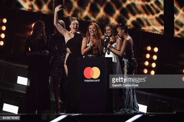 Perrie Edwards Jesy Nelson Jade Thirlwall and LeighAnne Pinnock of Little Mix receive the award for Best British Single on stage at The BRIT Awards...