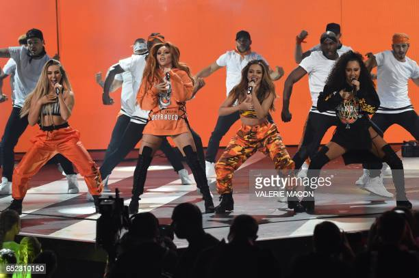 Perrie Edwards Jesy Nelson Jade Thirlwall and LeighAnne Pinnock of the group 'Little Mix' perform on stage at the 30th Annual Nickelodeon Kids'...