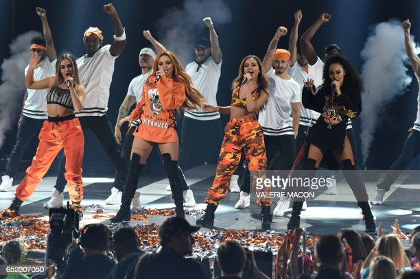 Perrie Edwards Jesy Nelson Jade Thirlwall and LeighAnne Pinnock the group 'Little Mix' perform on stage at the 30th Annual Nickelodeon Kids' Choice...
