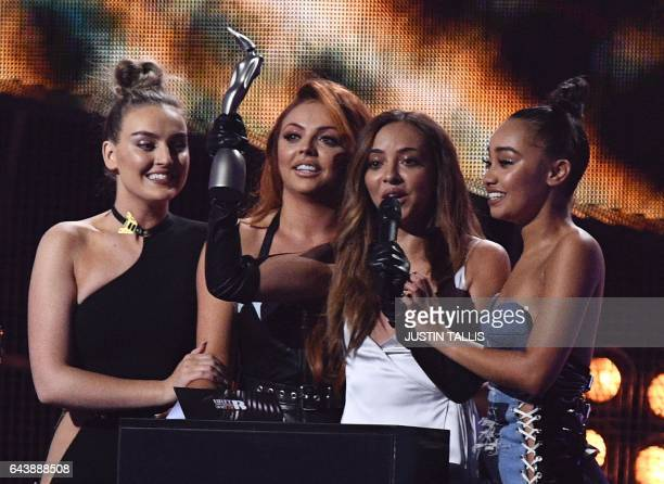Perrie Edwards Jesy Nelson Jade Thirlwall LeighAnne Pinnock of British girl group Little Mix celebrate with the award for a British single for 'Shout...