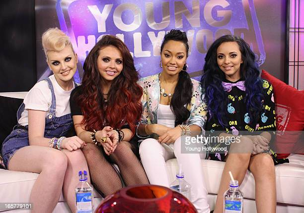 Perrie Edwards Jesy Nelson LeighAnne Pinnock and Jade Thirlwall of the band Little Mix visit with host Tracy Behr at the Young Hollywood Studio on...