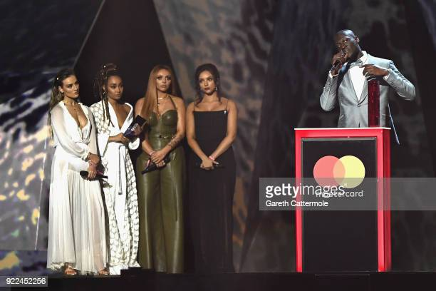 AWARDS 2018 *** Perrie Edwards Leigh Anne Pinnock Jesy Nelson and Jade Thirlwall of Little Mix present Stormzy with the Best British Male Solo Artist...
