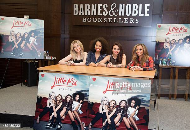 "Perrie Edwards, Leigh-Anne Pinnock, Jesy Nelson and Jade Thirlwall of Little Mix sign copies of their second studio album ""Salute"" at Barnes & Noble..."