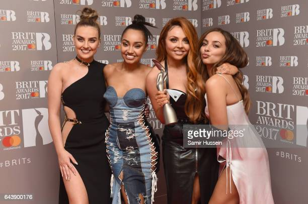 Perrie Edwards, Leigh-Anne Pinnock, Jesy Nelson and Jade Thirlwall of Little Mix pose with their award for Best British Single in the winner's room...