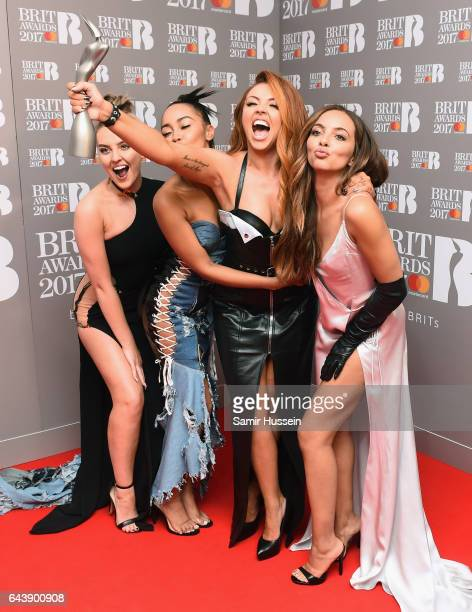 Perrie Edwards LeighAnne Pinnock Jesy Nelson and Jade Thirlwall of Little Mix pose with their award for Best British Single in the winner's room at...