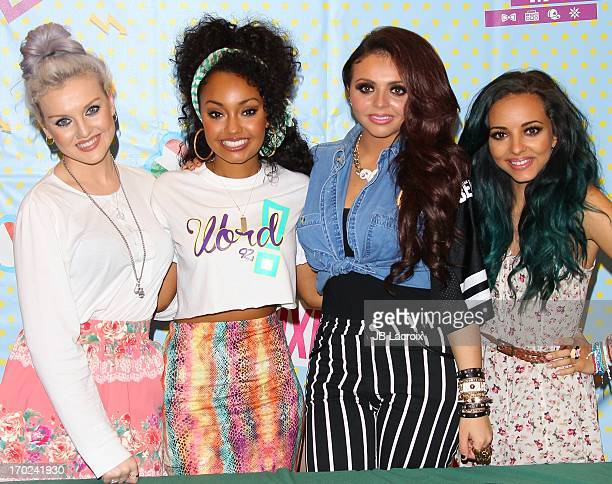 Perrie Edwards LeighAnne Pinnock Jesy Nelson and Jade Thirlwall of UK Pop sensation Little Mix sign copies of their Debut Album DNA at Barnes Noble...