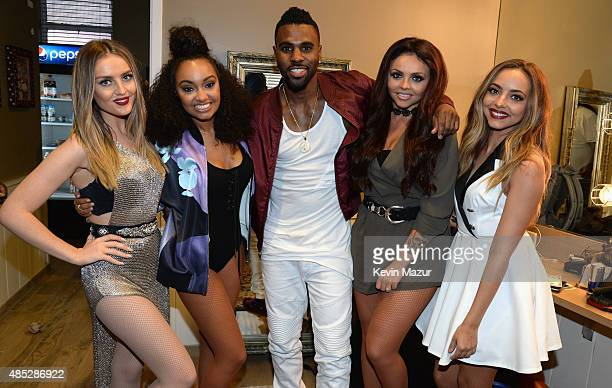 Perrie Edwards of Little Mix Jade Thirlwall of Little Mix Jason Derulo Jesy Nelson of Little Mix and LeighAnne Pinnock of Little Mix pose backstage...