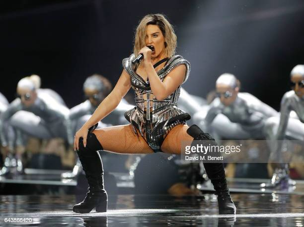 ONLY Perrie Edwards of Little Mix performs on stage at The BRIT Awards 2017 at The O2 Arena on February 22 2017 in London England