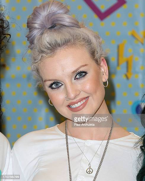 Perrie Edwards of the UK Girl Group Little Mix signs copies of their new album DNA on June 9 2013 in Los Angeles California