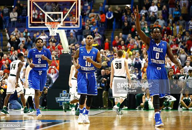 Perrin Buford Jaqawn Raymond and Darnell Harris of the Middle Tennessee Blue Raiders leave the court after defeating the Michigan State Spartans...