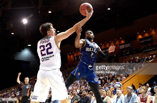 Perrin Buford of the Bullets and Dane Pineau of the Kings challenge for the ball during the round 11 NBL match between the Brisbane Bullets and the...