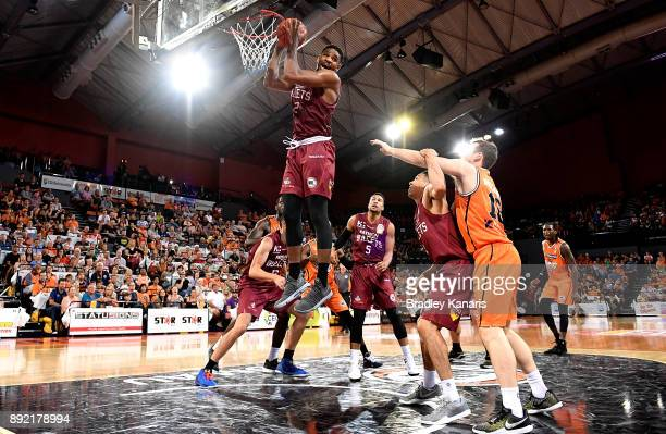 Perrin Buford of the Bullets takes a rebound during the round 10 NBL match between the Cairns Taipans and the Brisbane Bullets at Cairns Convention...