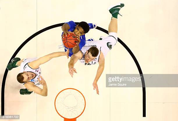 Perrin Buford of the Middle Tennessee Blue Raiders and Matt Costello of the Michigan State Spartans go up for the ball in the second half during the...