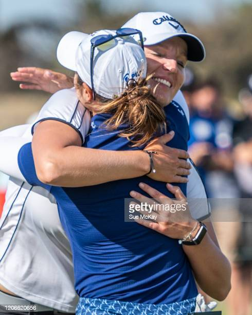 Perrine Delacour of France and Marina Alex of the USA embrace at the end of play during day four of the 2020 ISPS HANDA Women's Australian Open at...