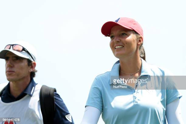 Perrine Delacour of France talks to her caddie on the 7th hole during the first round of the Marathon LPGA Classic golf tournament at Highland...