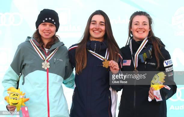Perrine Laffont of France celebrates winning the gold medal with silver medallist Yulia Galysheva of Kazakhstan and bronze medallist Jaelin Kauf of...