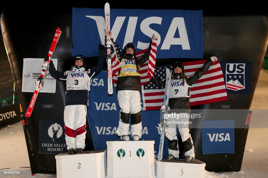 Perrine Laffont of France in second place, Jaelin Kauf of the United States in first place and Morgan Schild of the United States in third place celebrate on the podium for the Ladies' Moguls Finals during the 2018 FIS Freestyle Ski World Cup at Deer Valley Resort on January 11, 2018 in Park City, Utah.