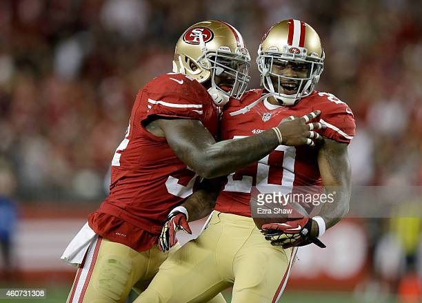 Perrish Cox of the San Francisco 49ers celebrates with Nick Moody after Cox intercepts a pass in the first quarter against the San Diego Chargers at...