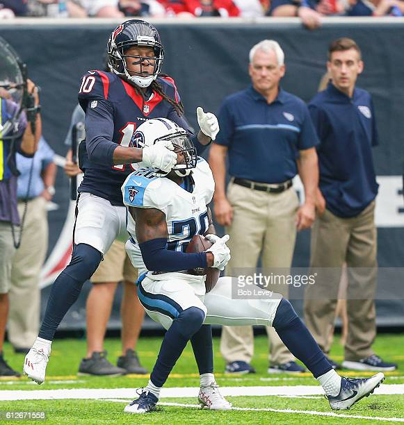 Perrish Cox of the Tennessee Titans intercepts a pass intended for DeAndre Hopkins of the Houston Texans at NRG Stadium on October 2 2016 in Houston...