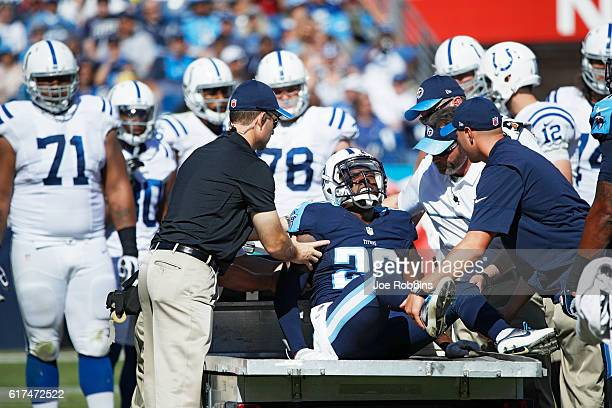 Perrish Cox of the Tennessee Titans is helped off the field after suffering an injury in the second quarter of the game against the Indianapolis...