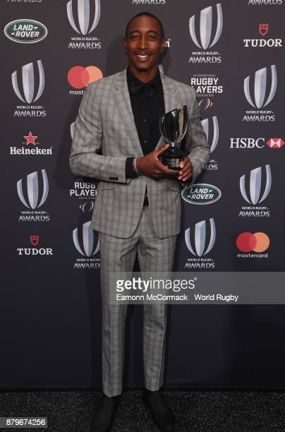 Perry Baker of the United States poses with the World Rugby Men's Sevens Player of the Year Award in association with HSBC during the World Rugby...