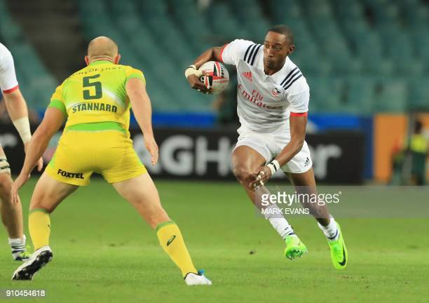 Perry Baker of the US runs with the ball as James Stannard of Australia looks on during the Sydney World Rugby Sevens Series tournament in Sydney on...