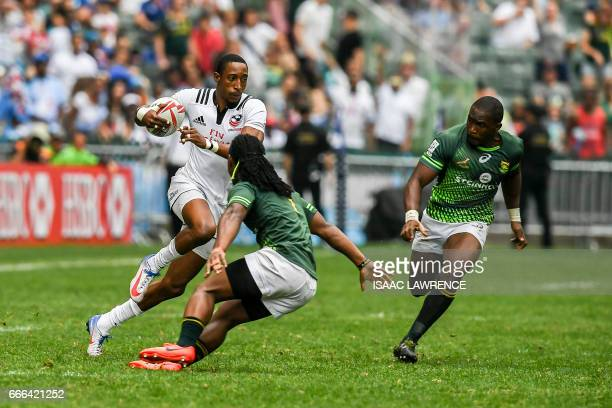 Perry Baker of the US runs with the ball while Branco du Preez of South Africa attempts a tackle during the Cup semifinal on the third day of the...