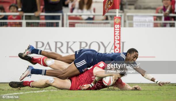 Perry Baker of USA fails to prevent Matt Mullins of Canada to score a try during the match United States vs Canada the Cup Final of the HSBC...