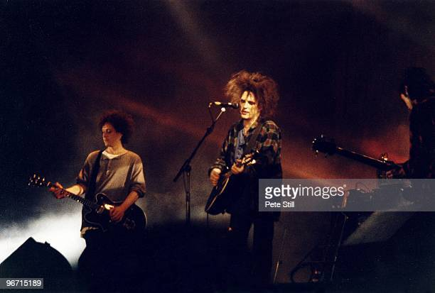 Perry Bamonte and Robert Smith of The Cure perform on stage in Finsbury Park on June 13th 1993 in London United Kingdom