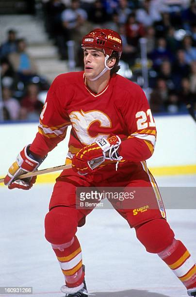 Perry Berezan of the Calgary Flames skates on the ice during an NHL game against the New York Islanders circa 1987 at the Nassau Coliseum in...