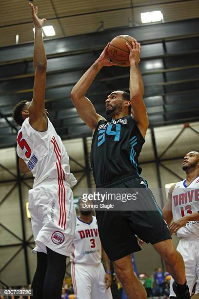 Perry Ellis of the Greensboro Swarm drives to the basket against the Grand Rapids Drive at The DeltaPlex Arena on December 30 2016 in Grand Rapids...