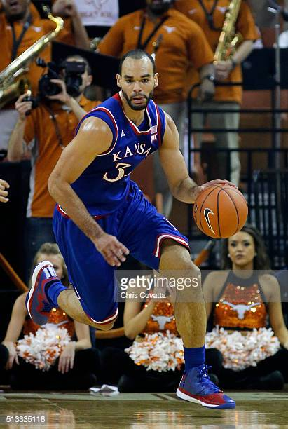 Perry Ellis of the Kansas Jayhawks brings the ball up court against the Texas Longhorns at the Frank Erwin Center on February 29 2016 in Austin Texas