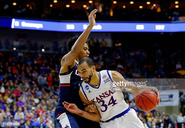 Perry Ellis of the Kansas Jayhawks drives against Shonn Miller of the Connecticut Huskies in the second half during the second round of the 2016 NCAA...