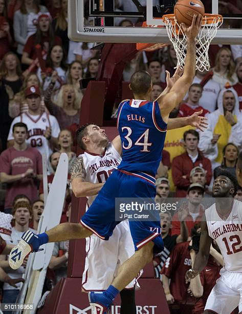 Perry Ellis of the Kansas Jayhawks drives around Ryan Spangler of the Oklahoma Sooners during a NCAA college basketball game at the Lloyd Noble...