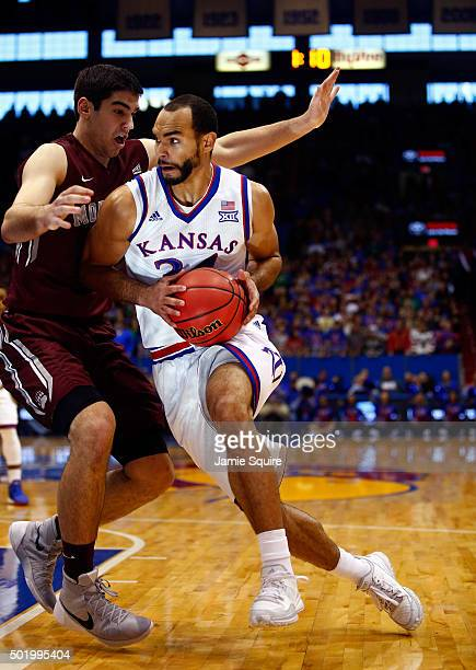 Perry Ellis of the Kansas Jayhawks drives as Martin Breunig of the Montana Grizzlies defends during the game at Allen Fieldhouse on December 19 2015...
