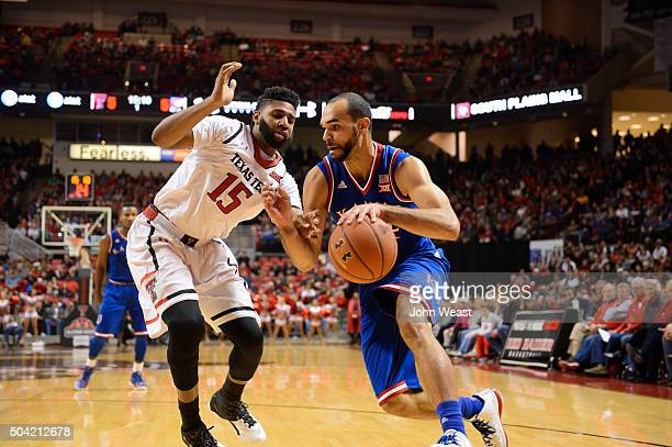 Perry Ellis of the Kansas Jayhawks drives to the basket against Aaron Ross of the Texas Tech Red Raiders during the first half on January 09 2016 at...