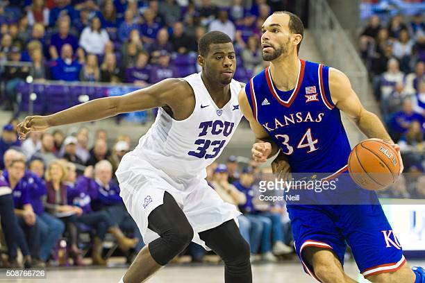Perry Ellis of the Kansas Jayhawks drives to the basket against Chris Washburn of the TCU Horned Frogs on February 6 2016 at the Ed and Rae...