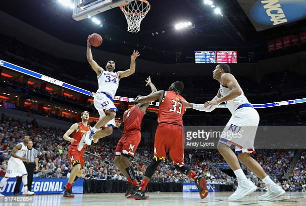 Perry Ellis of the Kansas Jayhawks drives to the basket against Robert Carter of the Maryland Terrapins and Diamond Stone in the first half during...