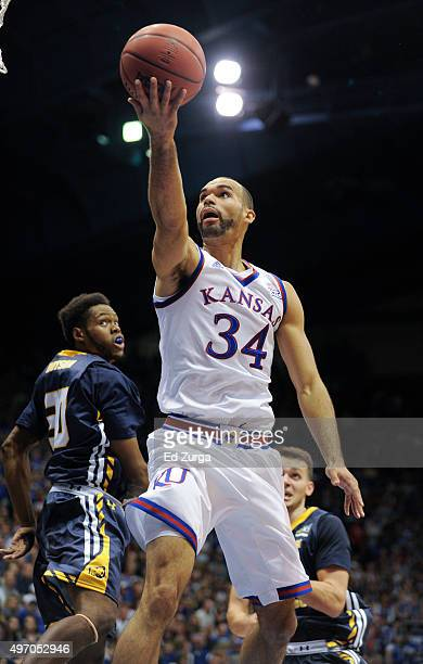 Perry Ellis of the Kansas Jayhawks drives to the goal against Jon'te Dotson of the Northern Colorado Bears in the first half at Allen Fieldhouse on...