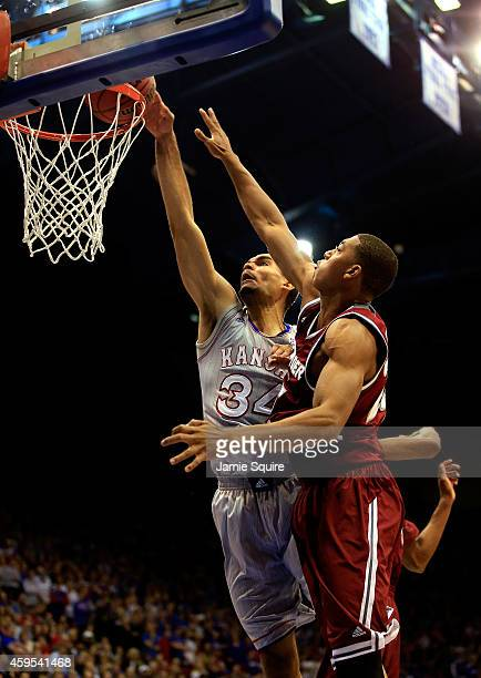 Perry Ellis of the Kansas Jayhawks dunks during the game against the Rider Broncs at Allen Fieldhouse on November 24 2014 in Lawrence Kansas