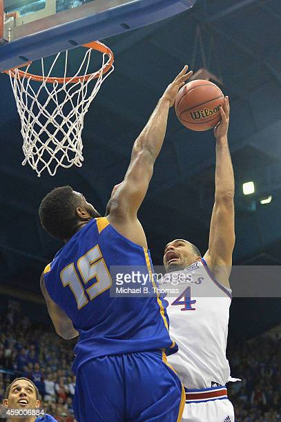 Perry Ellis of the Kansas Jayhawks has his shot blocked by Alan Williams of the UC Santa Barbara Gauchos in the first half at Allen Fieldhouse on...