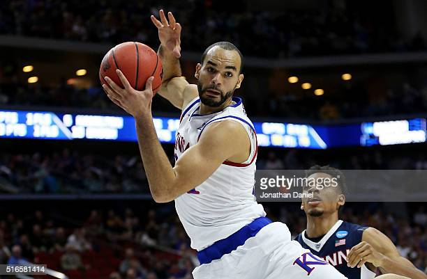 Perry Ellis of the Kansas Jayhawks rebounds against Shonn Miller of the Connecticut Huskies in the first half during the second round of the 2016...