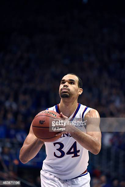 Perry Ellis of the Kansas Jayhawks shoots a free throw against the Kansas State Wildcats at Allen Field House on January 31 2015 in Lawrence Kansas
